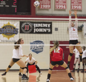 Middle hitter Raquel Valliere going up for a block against Glendale.