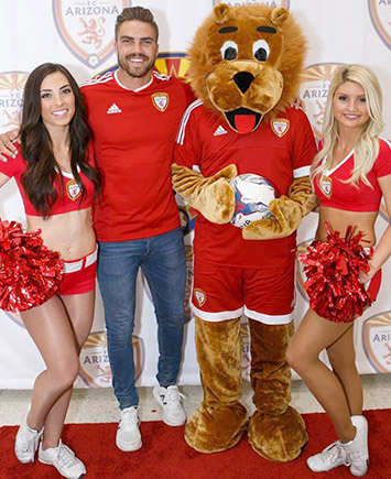 Weber with cheerleaders at launch party