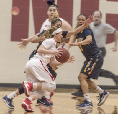 Tori Lloyd works her way through two defenders. (Photos: Tania Ritko / Mesa Legend)